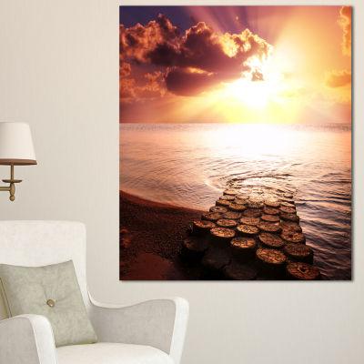 Designart Stunning Beach With Old Bridge SeascapeCanvas Art Print - 3 Panels