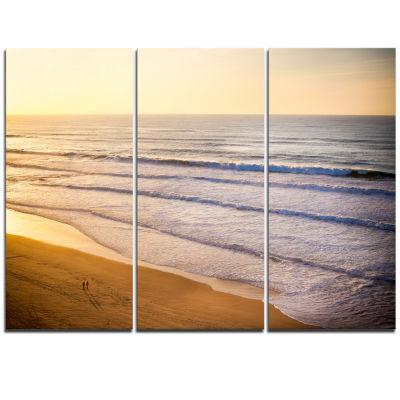 Designart Stunning Orange Sunset Over Beach ExtraLarge Seascape Art Triptych Canvas