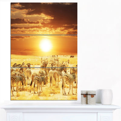 Designart Wandering Herd Of Zebra At Sunset ExtraLarge African Canvas Art Print - 3 Panels