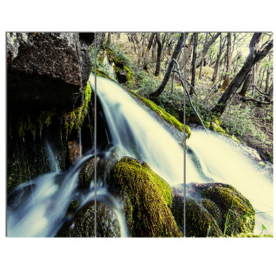 Designart Waterfall In Forest On Rocks Seashore Canvas Art Print - 3 Panels