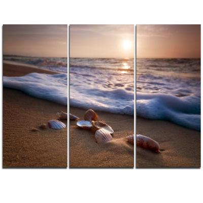 Designart Waves Approaching Seashells On Sand Beach Photo Triptych Canvas Print