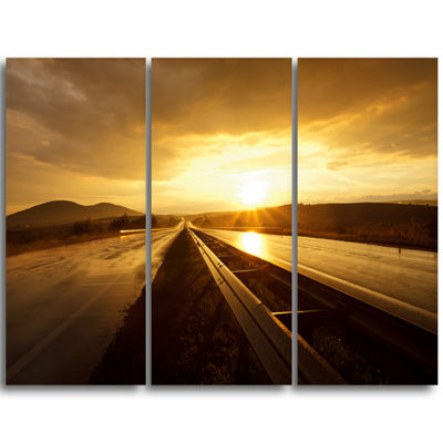 Designart Wet After Rain Road At Sunset Extra Large Wall Art Landscape