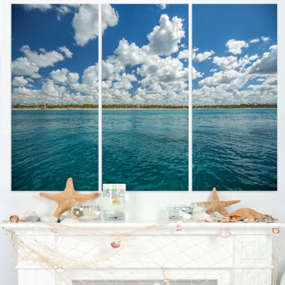 Designart White Fluffy Clouds Over Sea OversizedBeach Triptych Canvas Artwork