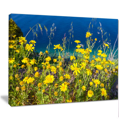 Designart Wild Yellow Flowers Over Sea Coast LargeFlower Canvas Art Print