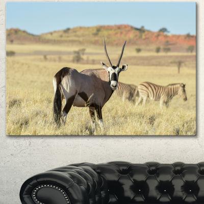 Designart Wildlife In Namibia Grassland African Canvas Art Print