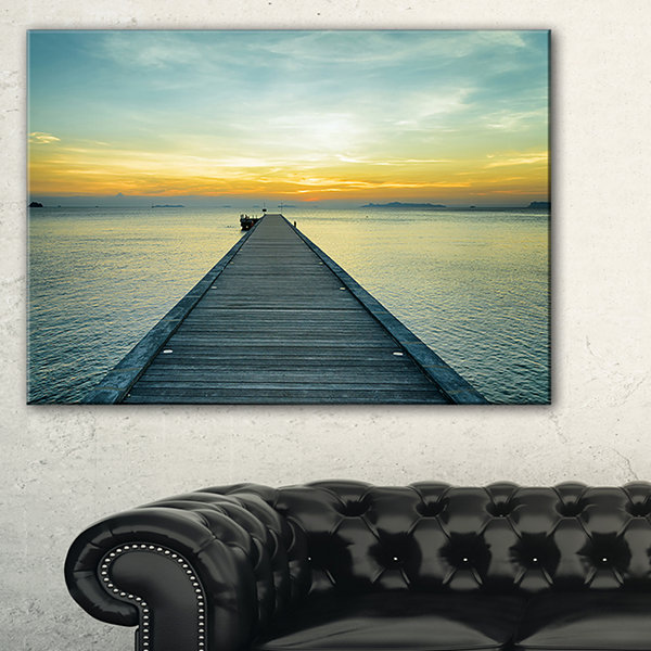 Designart Wood Pier Into The Yellow Blue Sea Wooden Sea Bridge Canvas Wall Art