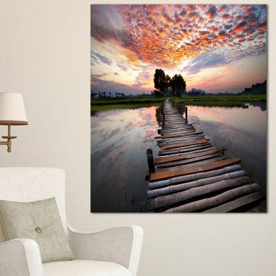 Designart Wooden Bridge Under Dramatic Sky Seashore Canvas Art Print