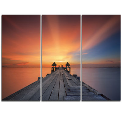 Designart Wooden Bridge Under Illuminated Sky PierSeascape Triptych Canvas Art Print