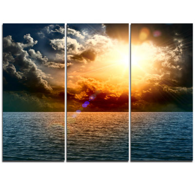 Designart Yellow Sunset In The Middle Of Ocean Beach Photo Triptych Canvas Print