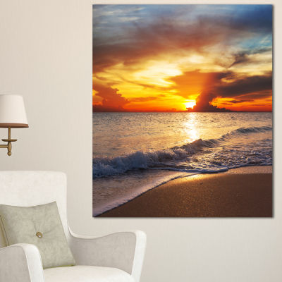 Designart Yellow Sunset Through Dark Clouds LargeSeashore Canvas Print