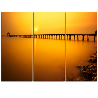Designart Yellow Tinged Seashore And Long Pier Pier Seascape Triptych Canvas Art Print