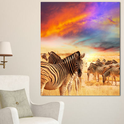 Designart Zebra Herd Under Colorful Sunset Sky Animal Art Canvas Print