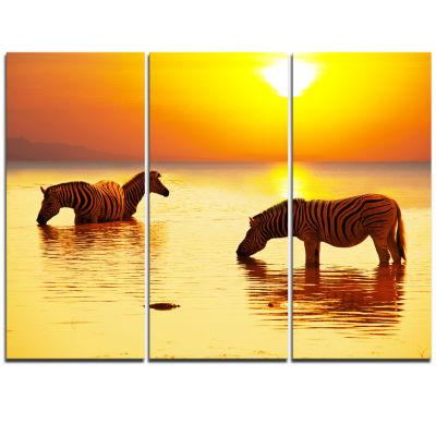 Designart Zebras Drinking In Lake At Sunset Animals Triptych Canvas Art Print