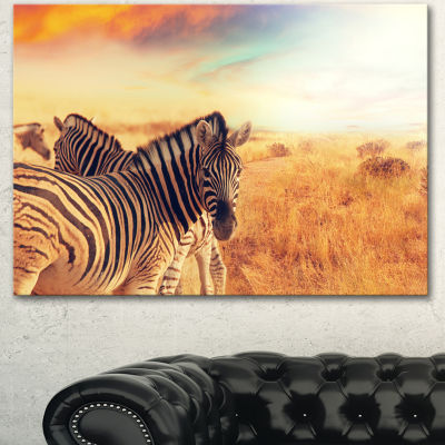 Designart Zebras Herd In Field At Sunset Extra Large African Canvas Art Print - 3 Panels