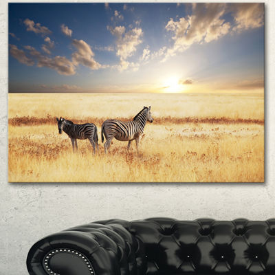 Designart Zebras In Beautiful Grassland At SunsetExtra Large African Canvas Art Print - 3 Panels