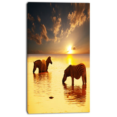 Designart Zebras In Water At Sunset African CanvasArt Print