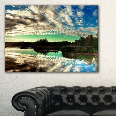 Designart Sky Clouds Mirrored In River Panorama Canvas Art