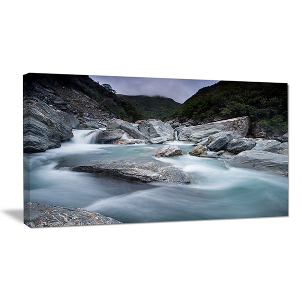 Designart Slow Motion Mountain River And Rocks Canvas Art