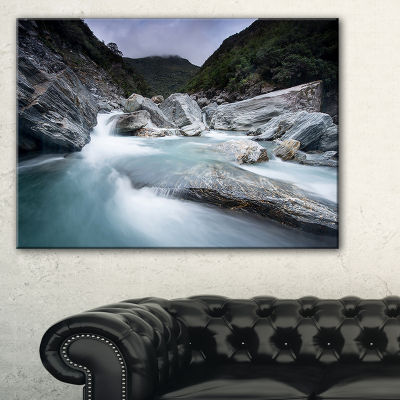 Designart Slow Motion Mountain River In Blue Canvas Art