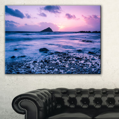 Designart Slow Motion Waves On Rocky Beach Canvas Art
