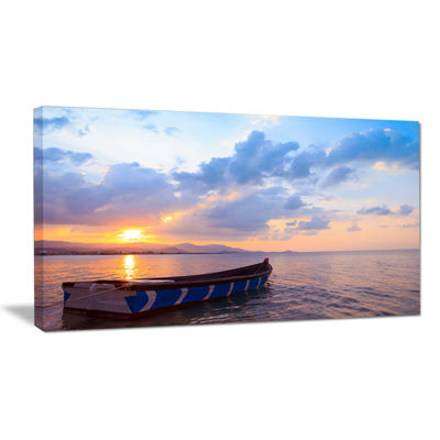 Designart Small Fishermen Boat At Sunset Canvas Art