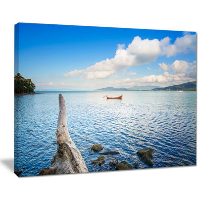 Designart Small Wooden Boat And Tree Trunk Canvas Art