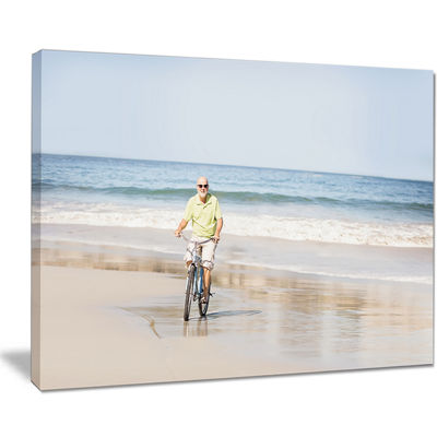 Designart Smiling Senior Man Riding Bike Canvas Art