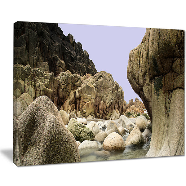 Designart Smooth Rocks In Coastline Panorama Canvas Art