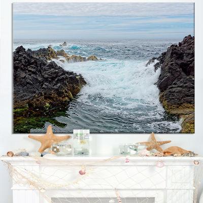 Designart Splashing Waters To Mossy Rock Canvas Art