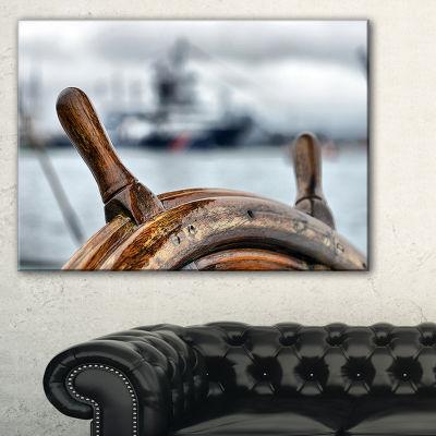 Designart Steering Wheel Sailboat Canvas Art