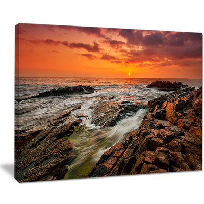 Designart Stormy Waves Rushing Into Rocks Canvas Art