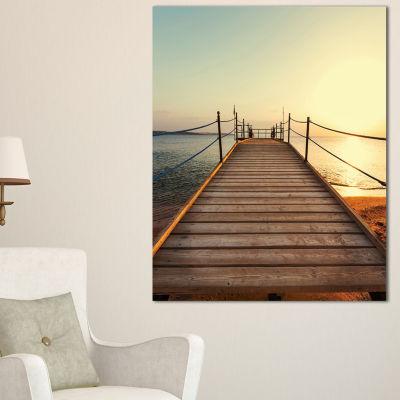 Designart Strong Wooden Boardwalk Into Sea Canvas Art