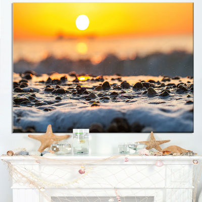 Designart Sunrise Giving Color For Sea Waters Canvas Art