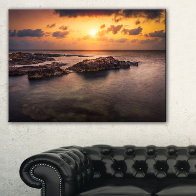 Designart Sunset Over African Seashore Canvas Art