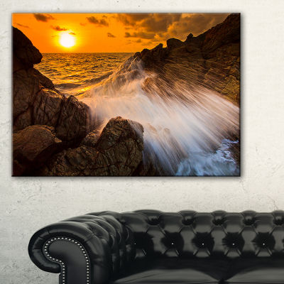 Designart Sunset Sea Wave Impact Rocks At Sunset Canvas Art