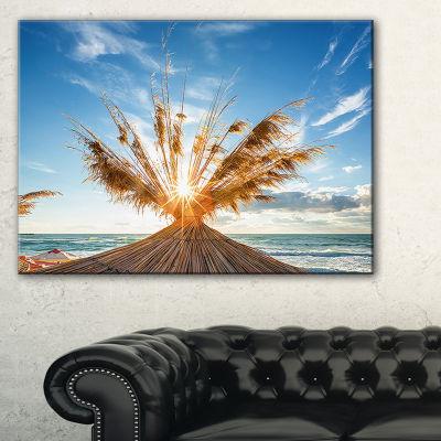 Designart Vivid Sunrise On Sandy Beach Canvas Art