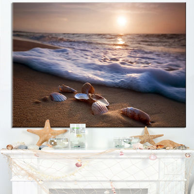 Designart Waves Approaching Seashells On Sand Canvas Art