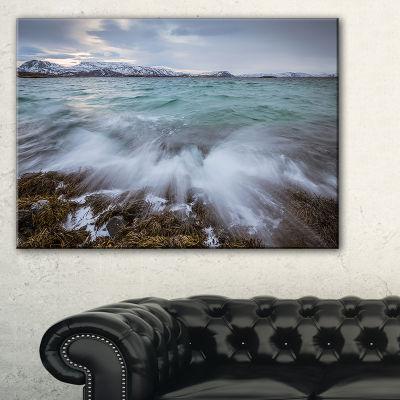 Designart Waves Splashing Rocks In Norway Canvas Art