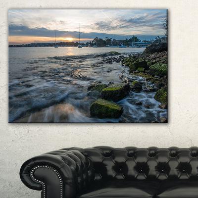 Designart White Waves Hitting Rocky Seashore Canvas Art