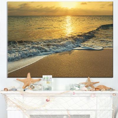 Designart White Waves Under Yellow Sunset Canvas Art