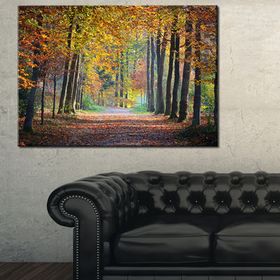 Designart Wide Pathway In Yellow Fall Forest Canvas Art
