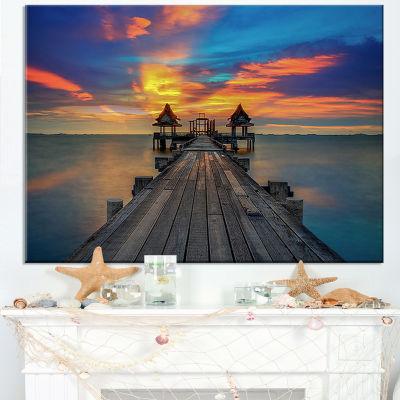 Designart Wide Wooden Bridge Into Distant Sun Canvas Art