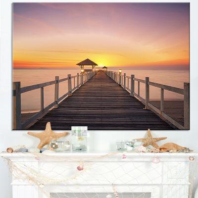 Designart Wide Wooden Bridge Into The Sea Canvas Art
