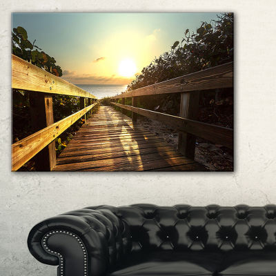 Designart Wood Boardwalk Into The Sunset Sea Canvas Art