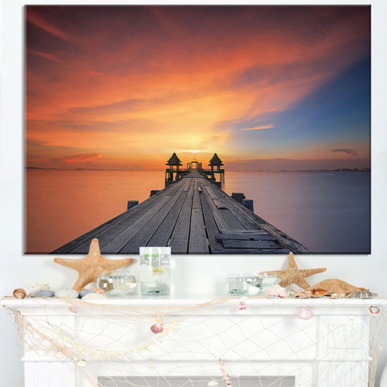Designart Wooden Bridge Straight Into The Sea Canvas Art