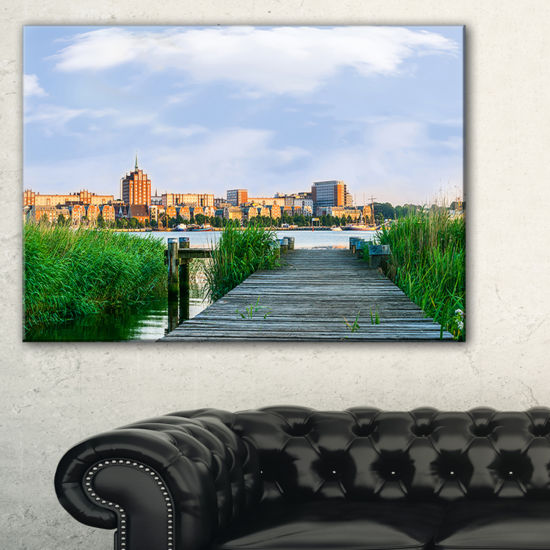 Designart Wooden Bridge To River Warnow Canvas Art