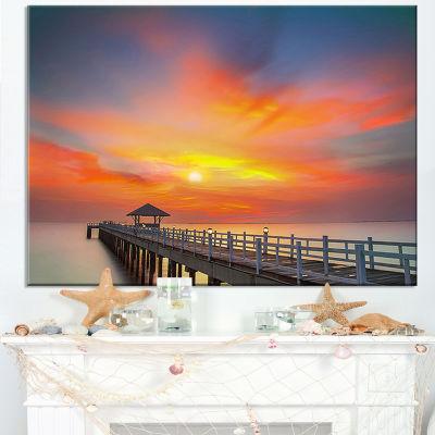 Designart Wooden Bridge Under Yellow Sky Canvas Art