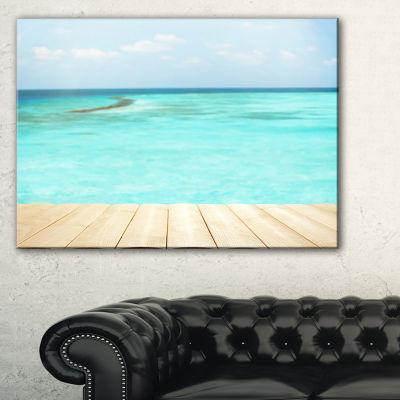 Designart Wooden Planks On Sea Background Canvas Art