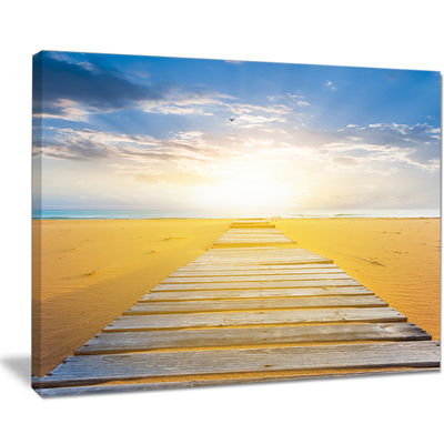 Designart Wooden Road At Blue Sea Beach Canvas Art
