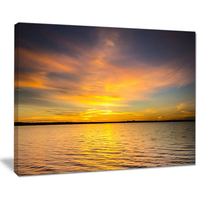 Designart Yellow Sunrise Light Hitting Waters Canvas Art